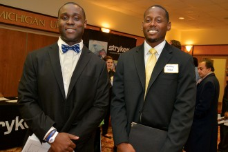 Photo of two attendees at the 2014 career fair.