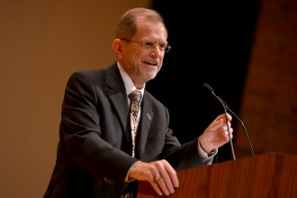 Photo of WMU President John M. Dunn speaking at a podium.