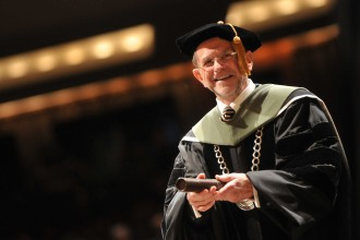 Photo of President John M. Dunn during a commencement ceremony.
