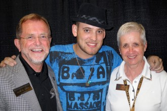 Photo of Dr. and Mrs. Dunn with alum and singer/songwriter Matt Giraud.
