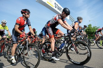 Photo of riders at the starting line during a past criterium.