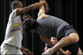 Photo of WMU students practice with DanceWorks professionals.