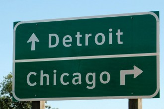 Photo of road sign in Kalamazoo pointing to Chicago and Detroit.