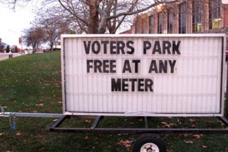 Photo of sign, Voters Park Free at any Meter.