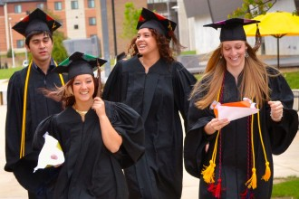 Photo of WMU graduates leaving commencement ceremony.