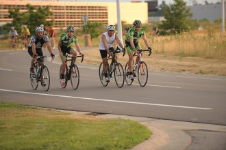 Photo of four bicyclists on the road at the Business, Technology and Research Park.