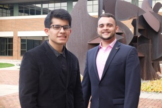 WMU students Abrahan Garcia and Alex Gutierrez-Spencer standing outside of WMU's Schneider Hall, home to the business college.