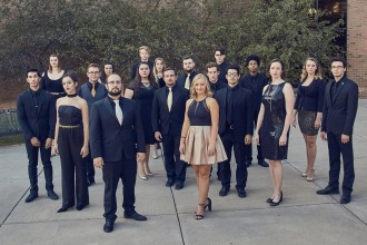 Members of WMU's Gold Company vocal jazz ensemble standing outside