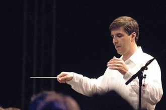 Musician Vince Mendoza holding a conductor's wand.