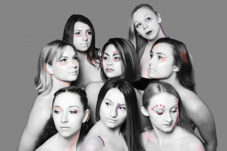 Black and white photo of eight female WMU dance students clustered together and looking off in different directions.