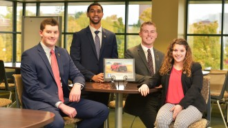 Photo of integrated supply management students John Hayward, Vernon Crump Jr., Jake Malone and Meriah Putnam.