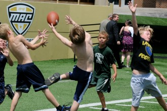 A  group of young boys playing football at Waldo Stadium.