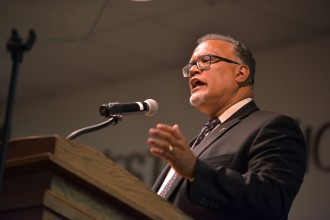 Photo of WMU President Edward Montgomery talking at a podium.
