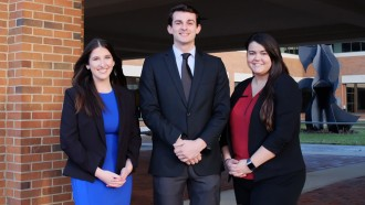 Photo of WMU students Sarah Obermeyer, Gabe Pelak and Stacy Zoeller.