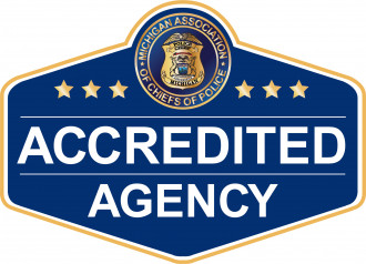 Badge that reads Michigan Association of Chiefs of Police Accredited Agency