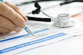 Stock photo of health insurance forms