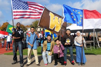 Photo of WMU students participating in the annual parade of flags
