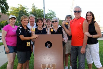 Image of the bean bag toss tournament champions and friends at the Administrative Professional Association's summer social.