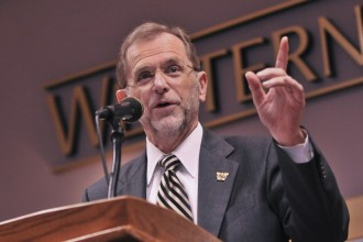 Image of University President John Dunn addressing congress attendees.