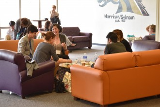 Image of attendees conversing in the Harrison-Stinson lobby of the Goldsworth Valley residence halls.