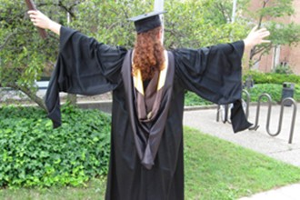 Image of a graduate in master's regalia.