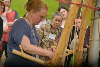 Image of a demostration of medieval weaving at the International Congress on Medieval Studies.