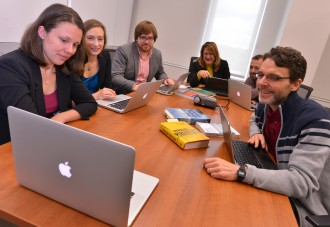 Faculty participate in Skype call.