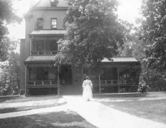 Woman outside Mitchell Cottage