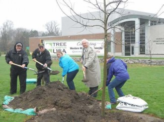 Planting tree in honor of Arbor Day