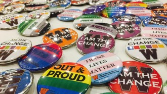 Multiple buttons that display positive LGBT messages such as: Out and Proud, Trans Lives Matter, I am the Change.