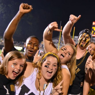 Photo of WMU students at a football game.