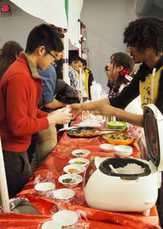 Photo of students serving traditional Japanese food during the 2016 International Education Week.
