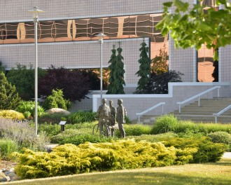 Photo of the landscaping and statues by Waldo Library.