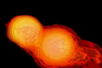 "Image simulating the collision of two neutron stars: Two orange ""balls"" are shown as they begin to collide and strip off each other's molten-red outer gases."