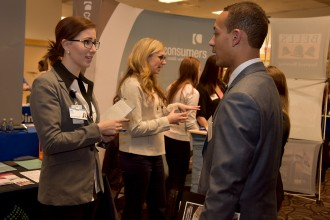 Photo of a male student interacting with a female Spectrum Health representative during the 2017 winter Career Fair.