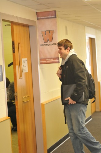 A student walking into the writing center