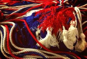 A photo of red, white and blue honor cords