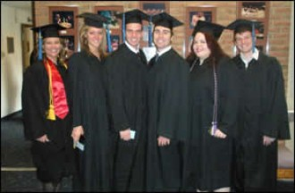 Photo of students in graduation robes