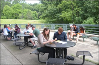 Photo of students studying on terrace