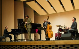 Photo of the Western Jazz Quartet performing on stage.