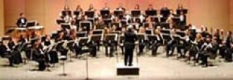 Photo of the University Symphonic Band performing a concert.