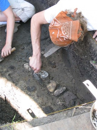 Students digging in an archeology project.