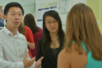 Students describing research posters