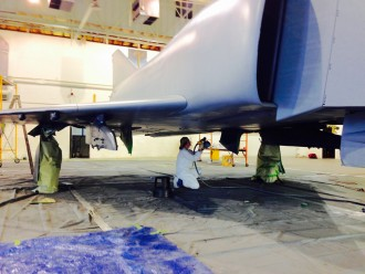 Claire Ranly painting plane