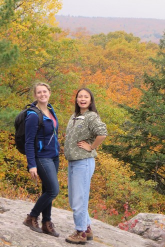 Two female students on overlook rock