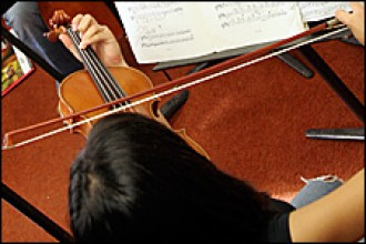Photo of a student playing the violin.