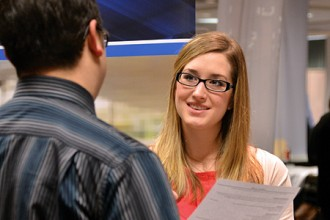 Photo of WMU student at career fair.