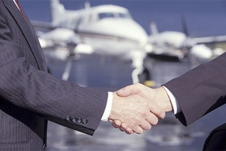 Photo of two businessmen shaking hands.