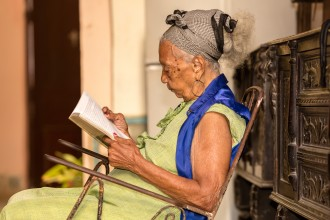 Photo of an older woman reading.