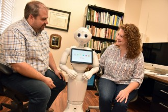 Photo of Drs. Chad and Autumn Edwards working with Pepper at WMU.